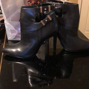 Guess black booties with gold detailing